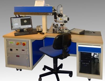 Universal laser drilling system for drawing die processing